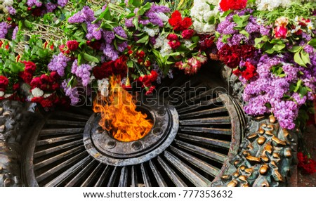 """Memorial to memory of Unknown Sailor of Eternal Flame to fallen defenders of Fatherland with flowers around fire. """"Eternal Flame"""" in memorial to fallen defenders of homeland. Victory Day, ODESSA, 2016 #777353632"""