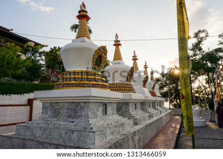 Memorials of Buddhist saints located at Monastery at Kharbandi Gompa-Phuentsholing, Bhutan. The monastery garden provides great views of the Phuentsholing town and the plains of West Bengal and Torsa #1313466059
