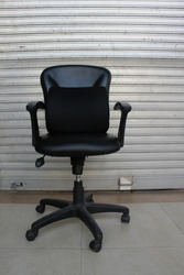 Memory foam lumbar support cushion in office chair outside the stall