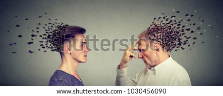 Memory loss due to dementia or brain damage. Side profile of young and senior men losing parts of head as symbol of decreased mind function.