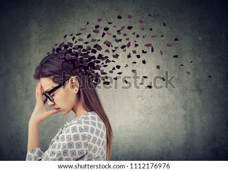 Memory loss due to dementia or brain damage. Young woman losing parts of head as symbol of decreased mind function.