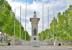 Memory Monument for soldiers killed in World Wars 1914-1918 and 1939-1941 Narbonne France among green trees