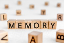 Memory - word from wooden blocks with letters, to remember information memory concept, random letters around white background