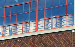 Memphis distillery is located in an old historic building.  Barrels can be seen through windows sitting in a row.