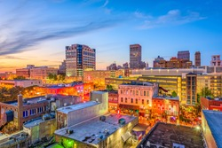 Memphis, Tennesse, USA downtown cityscape at dusk over Beale Street.