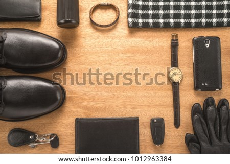 Men accessories on a wooden background #1012963384