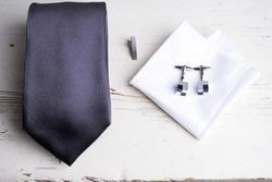 Men accessories on white wooden table