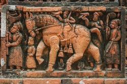 Men and horse going hunting with birds: intricate terracotta carving at Kantaji aka Kantajew medieval hindu temple in Kantanagar, Dinajpur district, Bangladesh