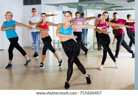 men and ladies dancing aerobics at lesson in the dance class Photo stock ©