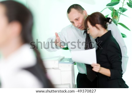 Men and nice girl with paper