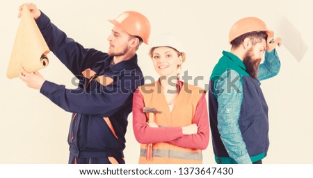 Men and woman in helmets carefree with hammer and project, white background. Insubordination concept. Inspector disappointed about employee, builder. Builder, architect, repairer lazy at work. #1373647430