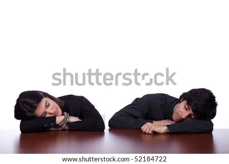 men and woman sleeping at the office desk