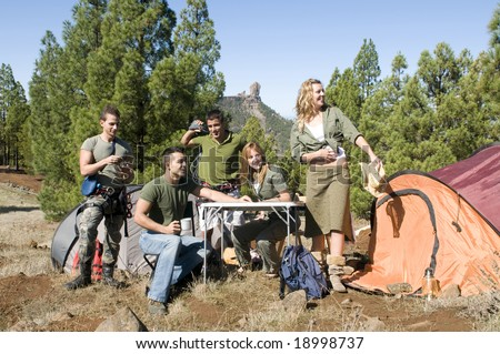 men and women group with maps and climb material at the mountain in camping