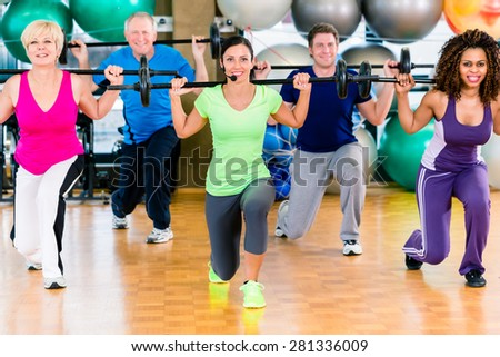 Men and women lifting barbell in gym, diversity group of old, young, black and white people #281336009