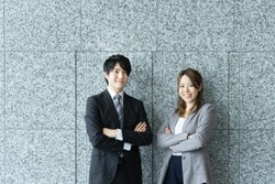 Men and women to be his arms folded with a smile (business image)
