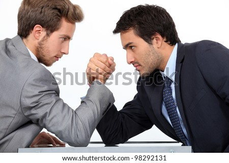 Men arm wrestling - stock photo