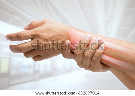 Men at higher risk of wrist fractures. Pain concept