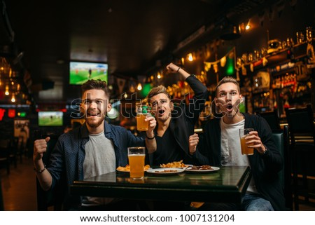 Men at the table with beer, crisps and crackers