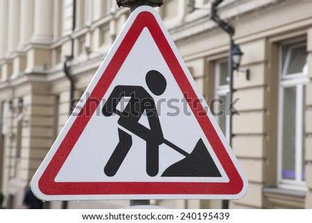 Men at Work Traffic Sign in Urban Setting