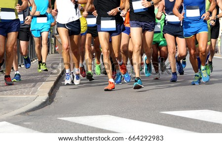 Men athletes run the marathon in the city without logos and brand #664292983