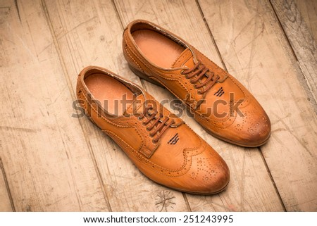 Men Brown Shoes on wooden background #251243995