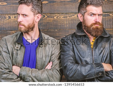 Men brutal bearded hipster. Confident competitors strict glance. Masculinity concept. Masculinity attributes. True man temper. Brutality confidence and masculinity interconnection. Exude masculinity.