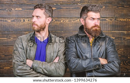 Men brutal bearded hipster. Exude masculinity. Confident competitors strict glance. Masculinity concept. Masculinity attributes. True man temper. Brutality confidence and masculinity interconnection.