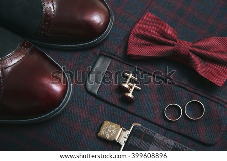 Men burgundy suit, bow tie and vintage leather shoes