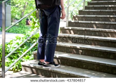 Men climb a refreshing fresh green of stairs