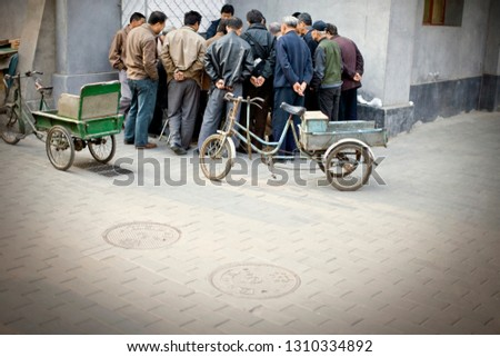 Men conversing on street corner #1310334892