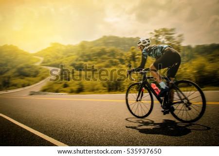 Men cycling mountain road bike in the morning