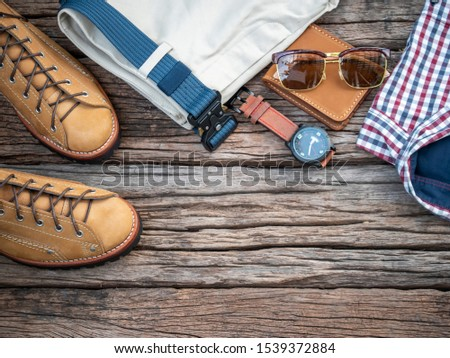 Men fashion clothing set and accessories on wooden background. Top view