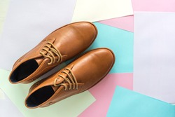 men fashion shoe on color paper background