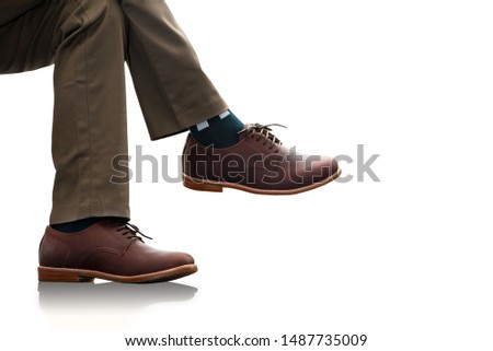 Men fashion. The male wears long pants and brown leather shoes for man collection clothing isolated on a white background.