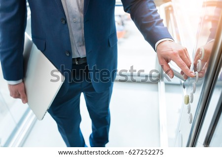 Men finger presses the elevator button. Businessman is a lift. high floor