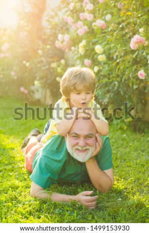 Men generation. Generation of people and stages of growing up. Grandpa retiree. Healthcare family lifestyle. Grandfather with son in park