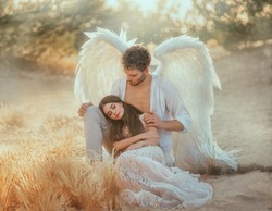Men guardian angel protects and hugs young woman. Sleeping beauty vintage pastel color, miracle dream. Fabulous old warm yellow autumn nature. Bright sun shine light. Creative white suit design wing