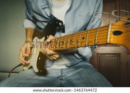 Men guitarist playing electric guitar