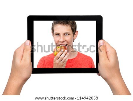 Men hands hold a tablet touch pad computer gadget with a boy and a red apple on the screen