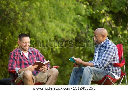 Men having a bible study on a camping trip. #1312435253