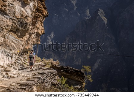 men hiking on the rocky mountain and the beautiful landscape of tiger leaping gorge,China #735449944