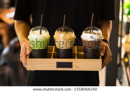 Men holding Beverage drinks ready to serve,cafe style,green tea ,coffee,chocolate #1358066540