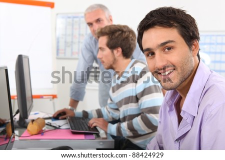 Men in computing training - stock photo