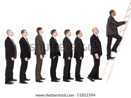 Men in line waiting to climb a ladder