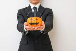 Men in mourning dress with Halloween pumpkin