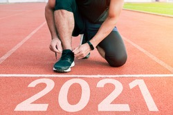 Men in sports uniform running around. A healthy way of life, and infused figure. sneakers close-up, finish in 2020. Start to the new year 2021 plans, goals, objectives