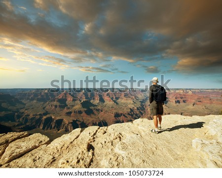 men looking from Grand Canyon