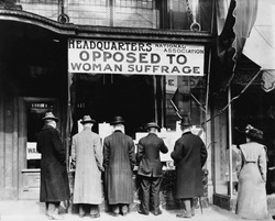 Men looking in the window of the National Anti-Suffrage Association headquarters, National Association Opposed to Woman Suffrage was active at the state and national. Ca. 1911.