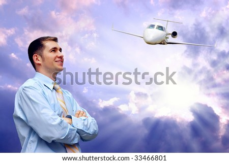 men looks at airplane in air with blue sky