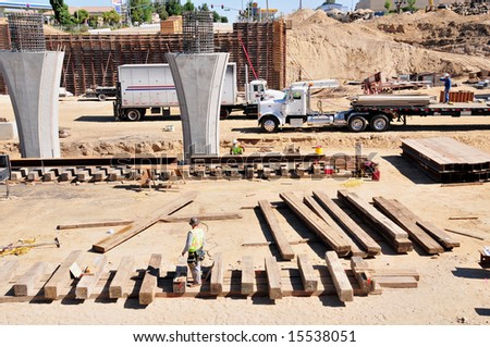 Men, material and machines construct a major freeway interchange, California